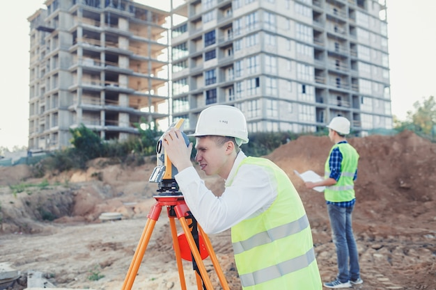 Two surveyor engineers