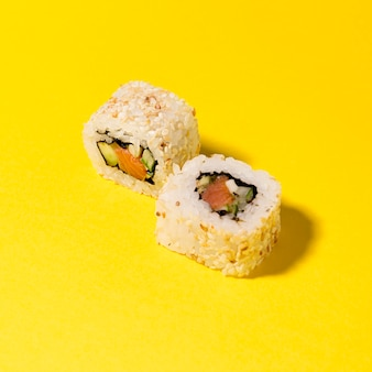 Two sushi rolls on table