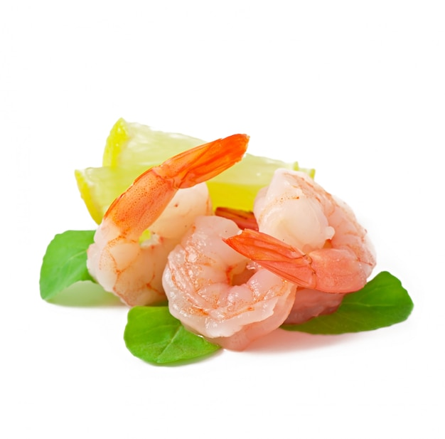 Two tail of shrimp with fresh lemon and rosemary on the white
