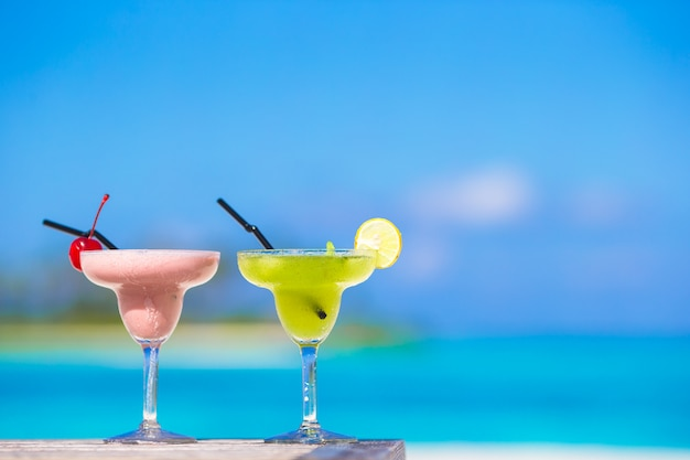 Two tasty cocktails on tropical white beach