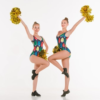 The two of teen cheerleaders posing