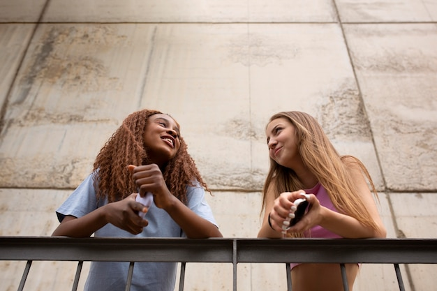 Two teenage girls spending time together outdoors