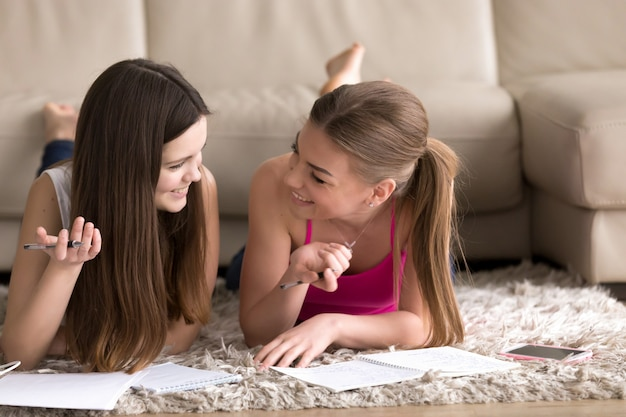 Two teenage girls studying at home