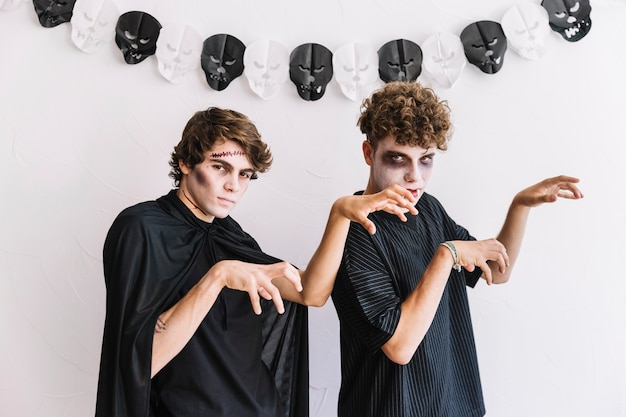 Two teenagers in halloween grim acting like zombie