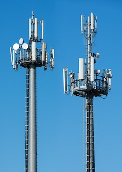 Two telecommunications towers with satellites