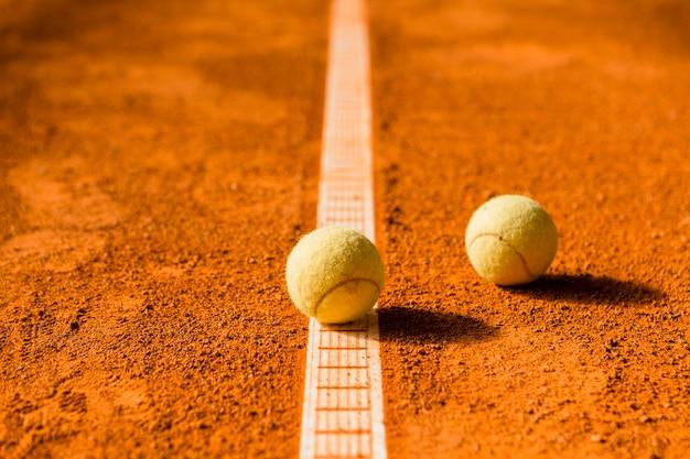Two tennis balls on line