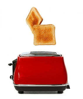 Two toasts jumping out of red toaster against white