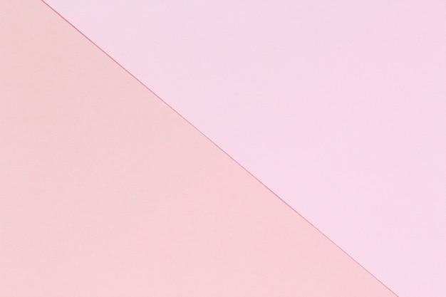 2つのトーンのピンク色の紙の背景