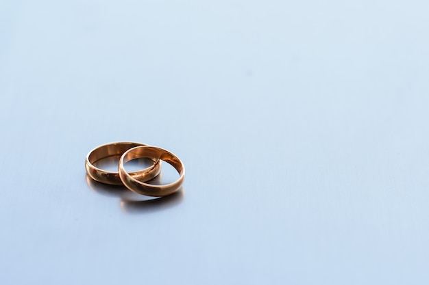 Two traditional wedding gold engagement rings lie