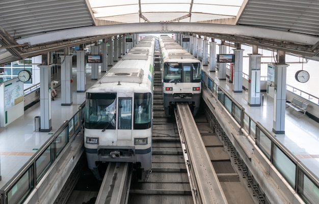 Two trains are in the subway station