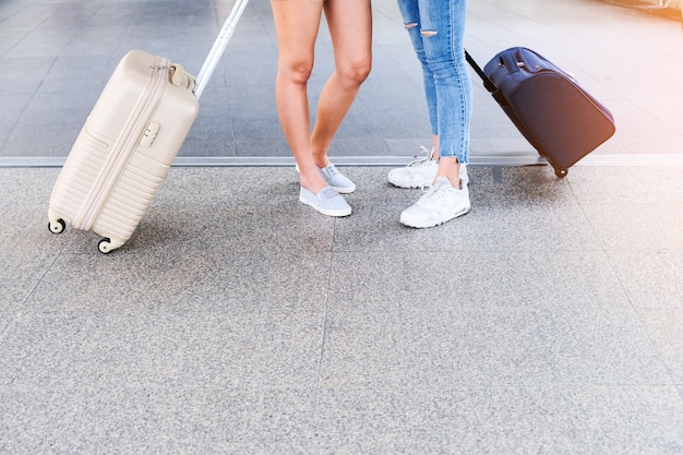Two travelers walking the bag.