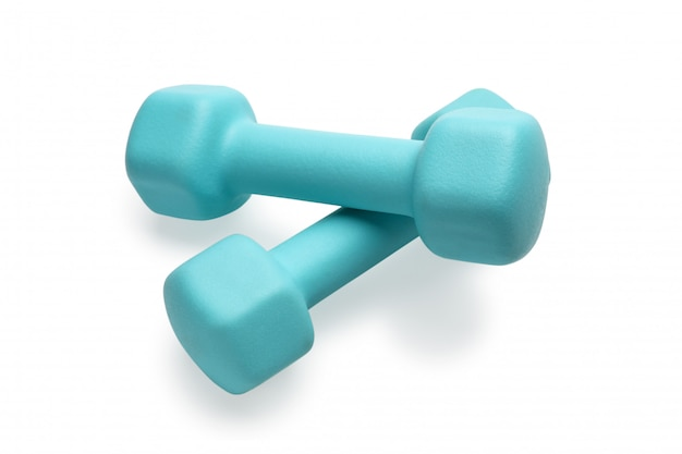 Two turquoise colored rubber dumbbells lying at white table
