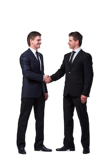 Two twin brothers handshaking isolated on white
