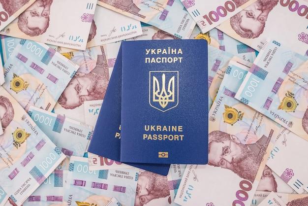 Два украинских паспорта на фоне гривны