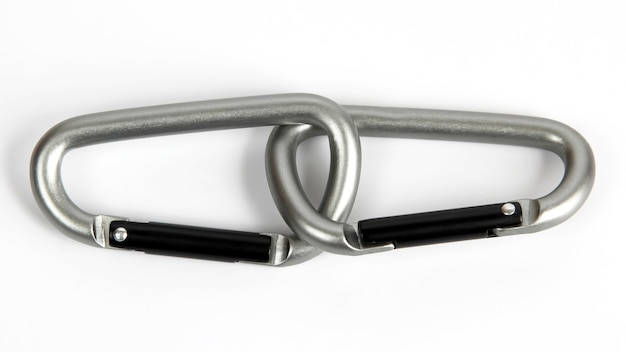 Two united grey climbing carabiner on a white background. everyday items