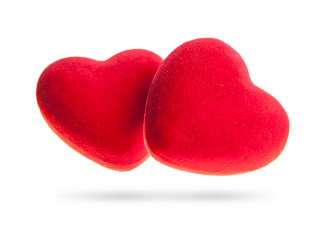 Two velvet hearts isolated on a white background.