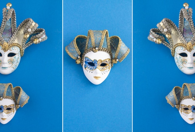 Two venetian carnival masks on the blue background. top view. location vertical.