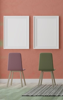Two vertical white frames and chairs on orange wall
