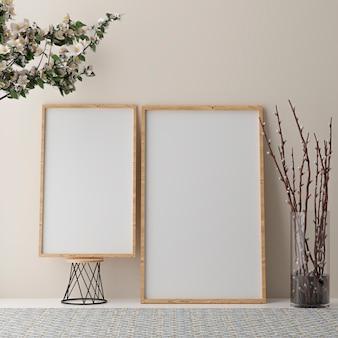 Две вертикальные белые рамки на бежевой стене