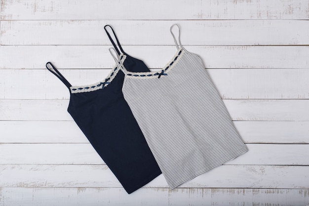 Two vest on wooden space. fashionable concept