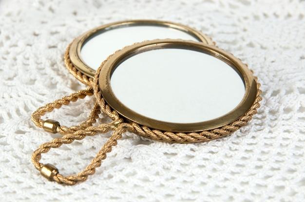 Two vintage brass hand mirror