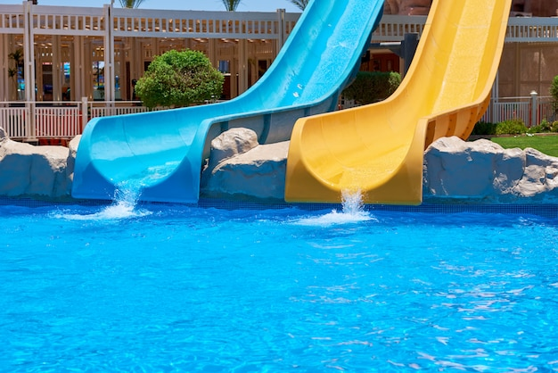 Two water slides in aqua park background of water park