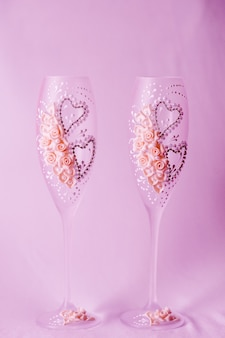 Two wedding glasses are decorated with flowers. close up.