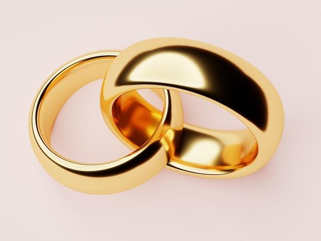2つの結婚式の金の指輪はお互いに横たわっています。愛の概念