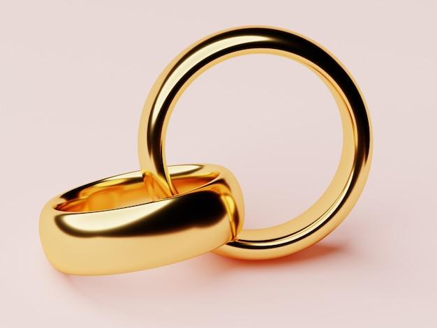2つの結婚式の金の指輪が互いに横たわっています