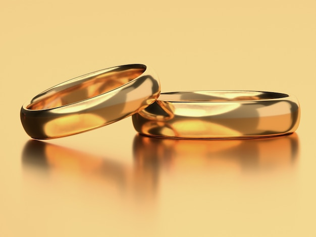 두 개의 금 결혼 반지가 나란히 놓여 있습니다. 사랑 개념