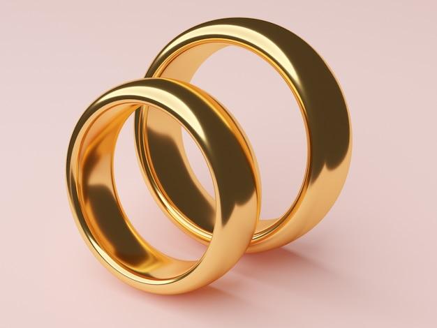 두 개의 금 결혼 반지가 나란히 놓여 있습니다.