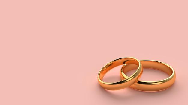 두 개의 결혼 금 반지는 빈 공간 배경으로 서로 놓여 있습니다