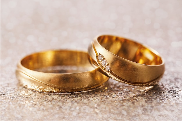 Two wedding rings on abstract background
