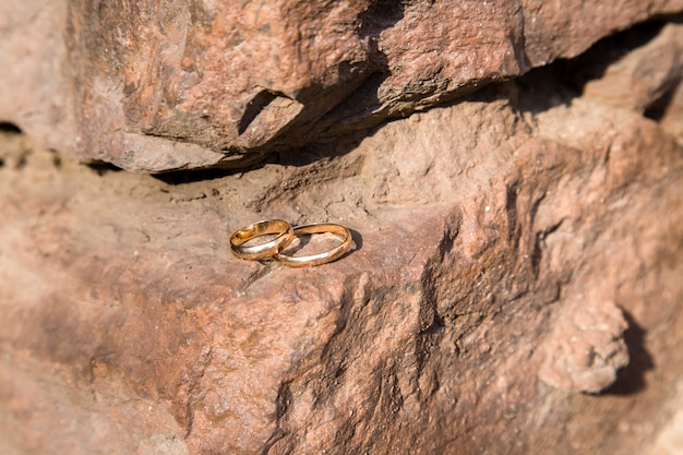 Two wedding rings on a old stone wall