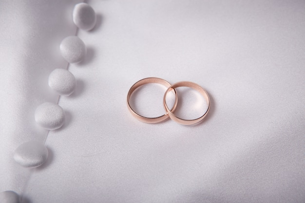 Two weddings rings on a fabric textile