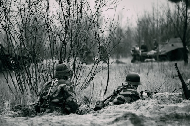 Two wehrmacht soldiers in the trenches are defending