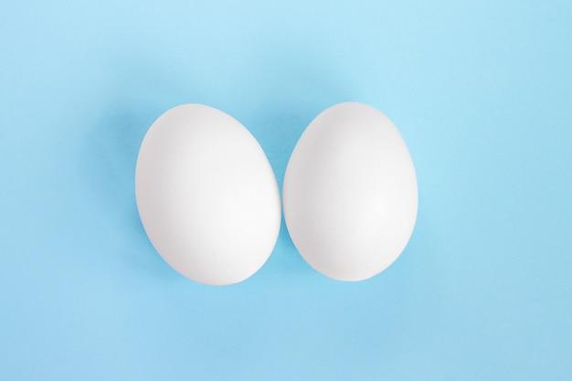 Two white egg on blue