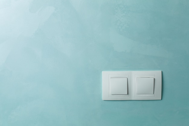 Two white sockets on a wall indoor close up