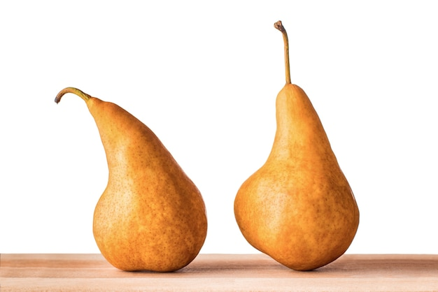 Two williams or bartlett pears on wooden table with isolated white background.