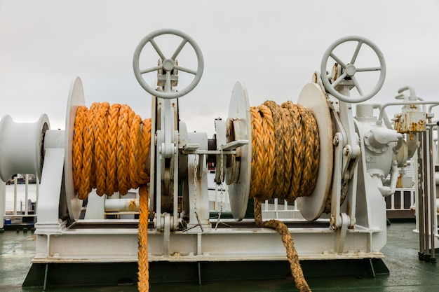 Two winches with orange rope on a ferry