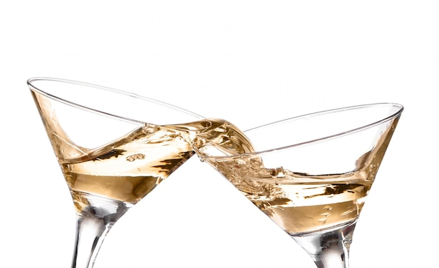 Two wine swirling in a goblet martini glass, isolated on a white background