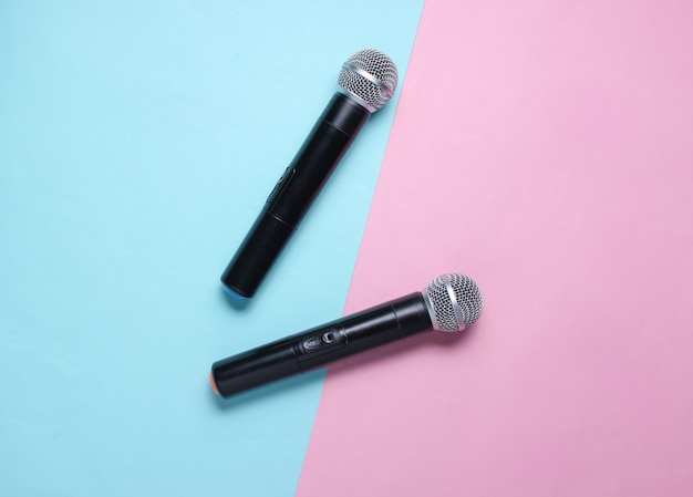 Two wireless microphone on blue pink pastel