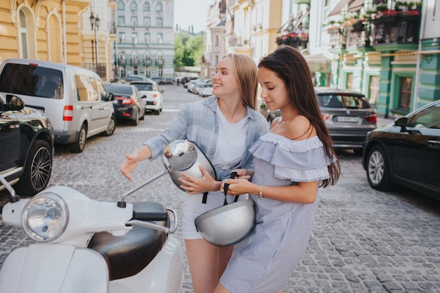 Two women are riding on one motorcycle