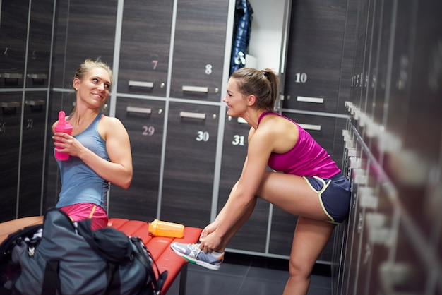 Two women in dressing room at gym