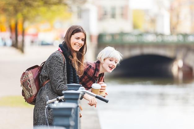 Two women having fun at canalside in berlin
