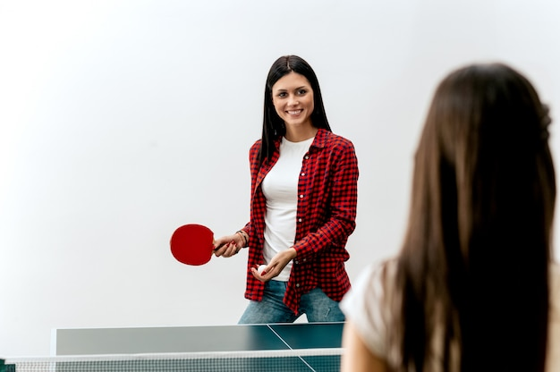Two women playing table tennis