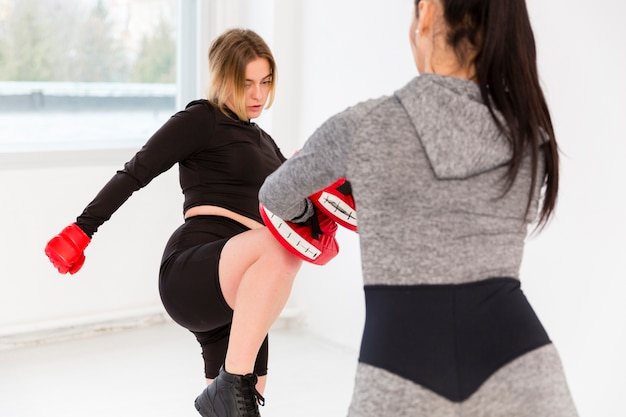 Two women practicing boxing