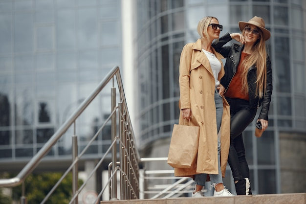 Two women standing in a autumn city