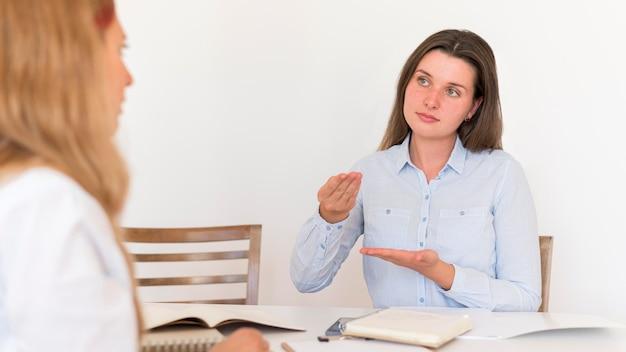 Two women using sign language to communicate
