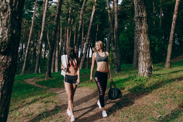Two women walk around after training
